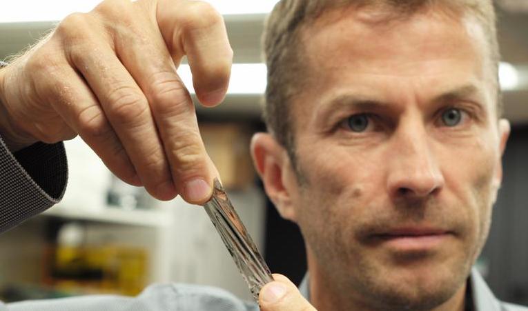 IBM scientist Dr Mark Lantz holds the sputtered tape which store around 330 tb data